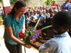 Laura Preston receives flowers from Tassah Academy students, 7/2014