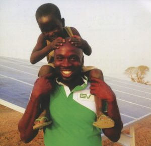 African father and son with pv solar array